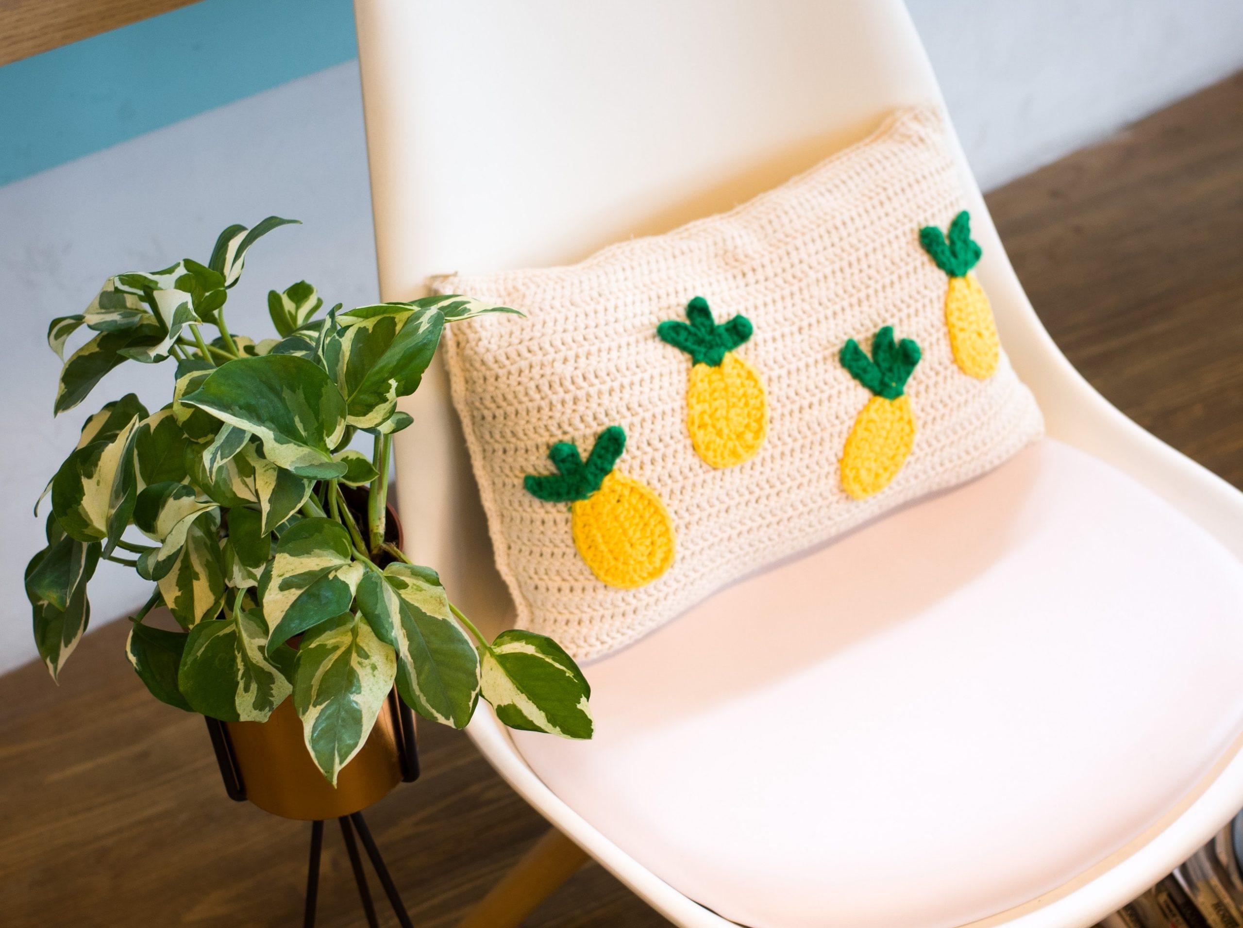 Cushion with pineapple appliqué